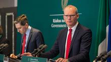 Talks postponed: Tánaiste Simon Coveney and Health Minister Simon Harris give an update to the media on Covid-19 protocols at Government Buildings yesterday. Photo: Gareth Chaney