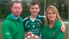 Captain Craig Raymond with team mentors Mr Murphy and Ms O'Connor