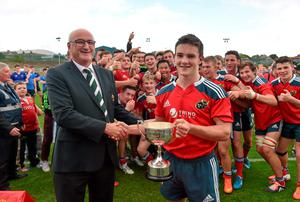 Captain Bill Johnston is presented with the cup by Greg Barrett of the IRFU Committee after Munster's victory over Leinster in the Under-18 Schools Interprovincial Championship in Cork. Photo: Diarmuid Greene / SPORTSFILE