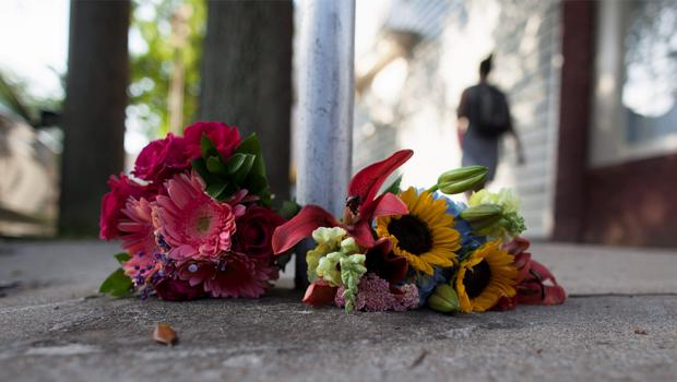 Flowers for the victims of Wednesday's shootings, are laid near a police barricade in Charleston, South Carolina, June 18, 2015. Police in Charleston were searching for a white gunman on Thursday who killed nine people in a historic African-American church, in an attack that police and the city's mayor described as a hate crime. REUTERS/Randall Hill