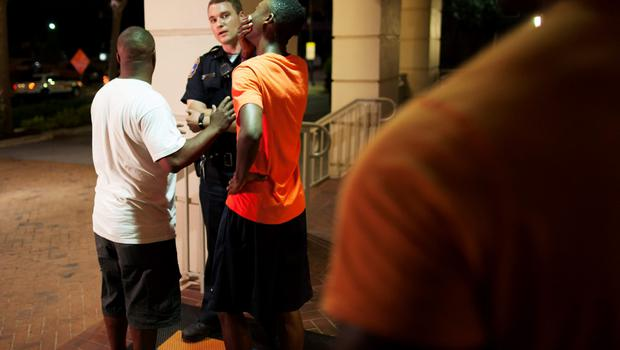 A man reacts while talking to police officer near the scene of shooting at the Emanuel AME Church in Charleston, South Carolina, June 17, 2015. A gunman opened fire on Wednesday evening at the historic African-American church in downtown Charleston, South Carolina.   REUTERS/Randall Hill