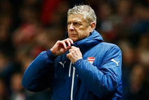 Arsene Wenger showed faith with the same defence that let a three-goal lead slip against Anderlecht, prompting criticism from former players such as Paul Merson. Photo credit: Michael Regan/Getty Images