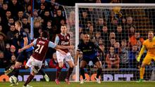 Burnley midfielder George Boyd (L) shoots to score the opening goal