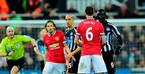 Newcastle's top scorer Papiss Cisse and his marker Jonny Evans had to be separated, both players seeming to accuse the other of spitting at the other, although referee Taylor took no action
