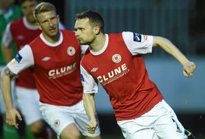 Daryl Kavanagh rushes to join as Conan Byrne turns away to celebrate after scoring for St Patrick's Athletic's at Richmond Park