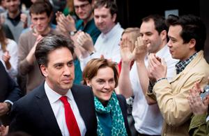 Labour leader Ed Miliband arrives with his wife Justine at the Labour party central office in Brewer's Green, London after travelling down from his Doncaster constituency, as according to reports he is expected to resign following sweeping losses in Scotland and with David Cameron close to an overall majority. PRESS ASSOCIATION Photo. Picture date: Friday May 8, 2015. See PA story ELECTION Labour. Photo credit should read: Stefan Rousseau/PA Wire
