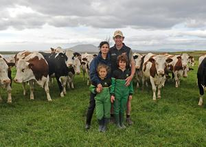 Richard and Lorena Austin with their 2 kids alongside their herd of pedigree Montbeliarde dairy cattle, The Colony Louisburgh. Photo Conor McKeown