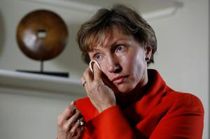 """Marina Litvinenko, the wife of former KGB agent Alexander Litvinenko who was murdered in London in 2006, wipes away a tear during an interview, as nine years after former KGB spy Alexander Litvinenko was poisoned in a plush London hotel in what has been described as Russian """"state-sponsored nuclear terrorism,"""" a public inquiry into his death finally begins in the British capital next week (REUTERS/Luke MacGregor)"""