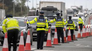 On alert: Gardaí stop vehicles at a Covid-19 checkpoint on the N7 in Dublin yesterday. Photo: Colin Keegan/Collins