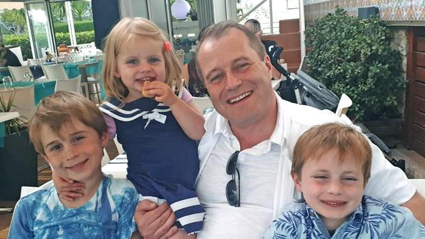 Tragic siblings Conor (9), Carla (3) and Darragh (7) with their dad Andrew McGinley