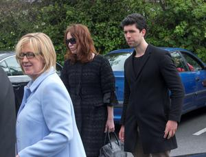 Ana Hick's mother Elga (on left) is comforted by the late DJ Gerry Ryans family including son Rex and wife Morah at her daughters funeral mass in the Church of the Assumption, Dalkey  Pic:Mark Condren 20.5.2015