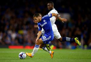 Chelsea's Eden Hazard is put under pressure by Medo Kamara of Bolton during their Captial One Cup game at Stamford Bridge. Photo: Richard Heathcote/Getty Images