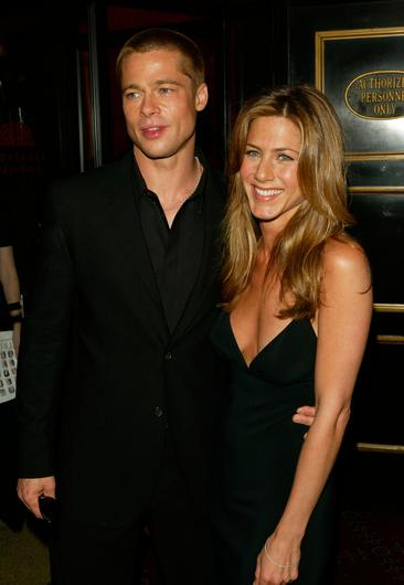 """Brad Pitt and Jennifer Aniston attend the premiere of """"Troy"""" May 10, 2004 in New York City.  (Photo by Peter Kramer/Getty Images)"""