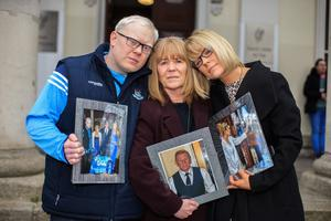 Struggling with their loss: June Fitzgerald holding a photo of her husband Christopher at Naas Circuit Court with her daughter June and son Gary