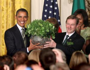 U.S. President Barack Obama receives a bowl of shamrock from Irish Prime Minister Enda Kenny in Washington...U.S. President Barack Obama (L) receives a bowl of shamrock from Irish Prime Minister Enda Kenny (R) during a St. Patrick's Day reception at the White House in Washington March 20, 2012. REUTERS/Chris Kleponis (UNITED STATES - Tags: POLITICS)...A