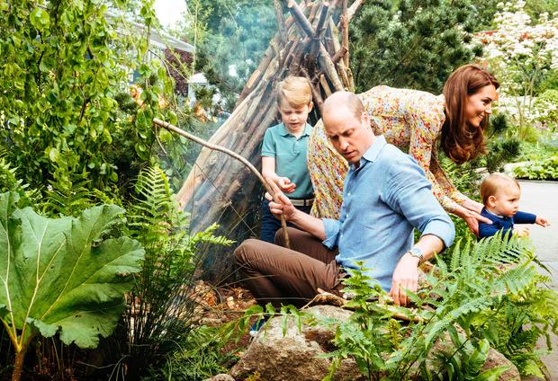 A picture released by Kensington Palace on May 19, 2019 shows Britain's Prince William, Duke of Cambridge and Britain's Catherine, Duchess of Cambridge with their children Prince George (L) and Prince Louis at the Adam White and Andree Davies co-designed 'Back to Nature' garden ahead of the RHS Chelsea Flower Show in London. (Photo by Matt Porteous / KENSINGTON PALACE / AFP)