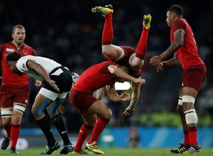 England's fullback Mike Brown (up) falls over England's scrum-half Ben Youngs in the Rugby World Cup clash against England. AFP PHOTO / ADRIAN DENNIS