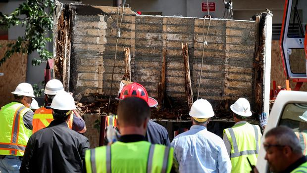 The floor section of the damaged balcony is laid on a flatbed truck in Berkeley, California