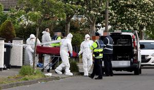 Gardai remove the body of Iranian asylum seeker Hamid Sanambar who was gunned down outside a house in Coolock