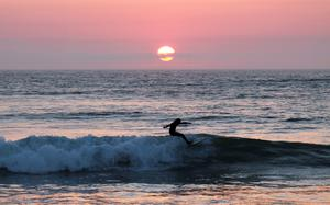 A surfer at sunset in Strandhill, Co. Sligo. Photo: Janell Carew