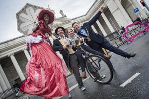 Right balance: Lord Mayor Paul McAuliffe and his daughter Millie (10) with Lady Logbottom and Mr Wobbly, Wobbly Circus at College Green, Dublin. PHOTO: ARTHUR CARRON