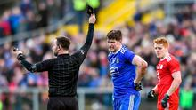 Black is the colour: Referee David Gough issues Monaghan's Darren Hughes with a black card in his side's league clash against Tyrone. Photo: Oliver McVeigh/Sportsfile