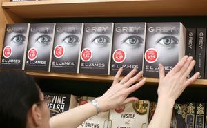 Jenny Nolan, stocks the shelfs with E.L. James' new Grey; Fifty Shades of Grey book at Easons in O'Connell St, Dublin