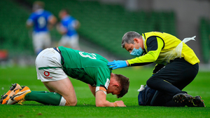 Garry Ringrose is attended to by team physio Keith Fox after suffering a broken jaw during Ireland's Six Nations clash with Italy at the Aviva. Photo: Brendan Moran/Sportsfile