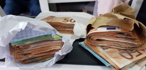 Raid: Some of the cash seized in the Criminal Assets Bureau raid, which amounted to €66,865. Also seized were an Audi car and two phones
