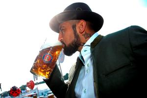 Arturo Vidal of FC Bayern Munich poses during a visit at the Oktoberfest in Munich, Germany, September 30, 2015. REUTERS/Alexander Hassenstein/Pool