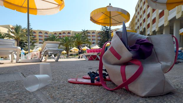 A general view shows items belonging to tourists at the swimming pool at the Thalasso & Spa hotel in the resort town of Sousse, a popular tourist destination 140 kilometres (90 miles) south of the Tunisian capital, on June 26, 2015, following a shooting attack. At least 27 people, including foreigners, were killed in a mass shooting at a Tunisian beach resort packed with holidaymakers, in the North African country's worst attack in recent history. AFP PHOTO / FETHI BELAIDFETHI BELAID/AFP/Getty Images