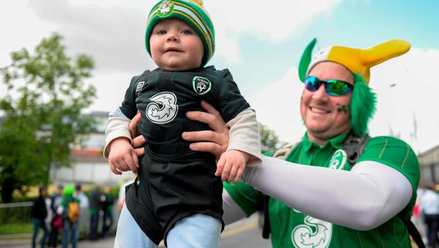 7 June 2015; Republic of Ireland supporters Gareth Crawley with his 11 month old son Kai, from Dundalk, Co. Louth, on their way to the game. Three International Friendly, Republic of Ireland v England. Aviva Stadium, Lansdowne Road, Dublin. Picture credit: Cody Glenn / SPORTSFILE
