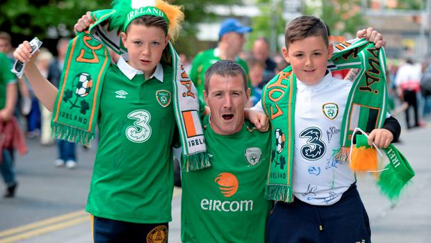 7 June 2015; Republic of Ireland supporters Shane McCormack, centre, with his two sons John, left, age 12, and John, age 11, from Mullingar, Co. Westmeath, on their way to the game. Three International Friendly, Republic of Ireland v England. Aviva Stadium, Lansdowne Road, Dublin. Picture credit: Cody Glenn / SPORTSFILE