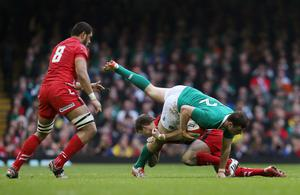 Rugby Union - Wales v Ireland - RBS Six Nations Championship 2015 - Millennium Stadium, Cardiff, Wales - 14/3/15 Ireland's Robbie Henshaw in action with Wales' Dan Biggar Action Images via Reuters / Paul Childs Livepic EDITORIAL USE ONLY.