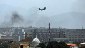 A U.S. Chinook helicopter flies over the city of Kabul,. Photo: AP
