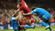 Wales' Jamie Roberts is tackled by Italy's Edoardo Gori (left) and Mauro Bergamasco (right) during the RBS 6 Nations match at the Millennium Stadium, Cardiff. PRESS ASSOCIATION Photo.