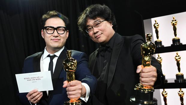 "Bong Joon Ho and Han Jin Won hold their Oscar statues for Original Screenplay for ""Parasite"" at the 92nd Academy Awards in Hollywood, Los Angeles, California, U.S., February 9, 2020. Matt Petit/A.M.P.A.S./Handout via REUTERS ATTENTION EDITORS. T"