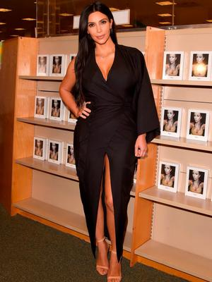 Kim Kardashian West wears a plunging maxi dress for her Selfish book signing in May.