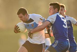 Caolan O'Boyle, UUJ, in action against Paddy McGuigan, Monaghan