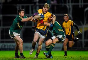 Conor McGraynor, DCU, in action against Adam Flanagan and Graham Reilly, Meath
