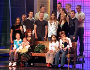 (FILES) This photo taken on December 11, 2005 shows then 55-old Annegret Raunigk (1st row, 2ndL), posing with her youngest daugher Lelia (on her knees) and other children and grand-children in Cologne as guest in a German channel RTL show ?2005! People, Photos, Emotions?. A 65-year-old Annegret Raunigk,who already has 13 children is pregnant again with quadruplets, German media reported April 12, 2015. AFP PHOTO / DPA / JOERG CARSTENSEN +++GERMANY OUTJ?rg Carstensen,JOERG CARSTENSEN/AFP/Getty Images