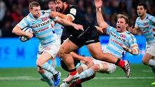 Racing 92 fly-half Finn Russell (L) is tackled by Saracens' Titi Lamositele. Photo: MARTIN BUREAU/AFP via Getty Images