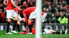 Wayne Rooney is congratulated by teammates after scoring his team's third goal