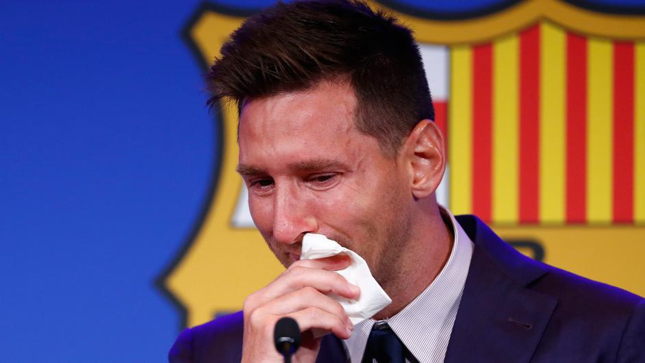 Lionel Messi cries at the start of a press conference at the Nou Camp stadium in Barcelona after announcing he would be leaving the club. (AP Photo/Joan Monfort)