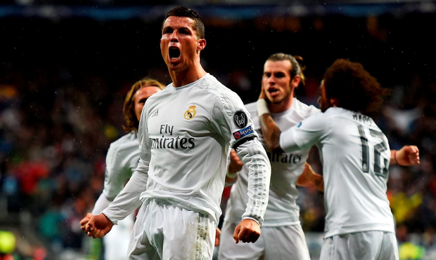 MADRID, SPAIN - APRIL 12: Cristiano Ronaldo of Real Madrid (7) celebrates with team mates as he scores their second goal during the UEFA Champions League quarter final second leg match between Real Madrid CF and VfL Wolfsburg at Estadio Santiago Bernabeu on April 12, 2016 in Madrid, Spain. (Photo by Mike Hewitt/Getty Images)