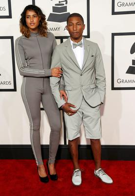 Musician Pharrell Williams and his wife, Helen Lasichanh, arrive at the 57th annual Grammy Awards in Los Angeles, California February 8, 2015.