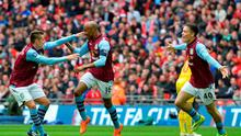 Aston Villa's English midfielder Fabian Delph (C) celebrates with Aston Villa's English midfielder Ashley Westwood (L) after scoring during the FA Cup semi-final between Aston Villa and Liverpool at Wembley stadium in London on April 19, 2015. AFP PHOTO / GLYN KIRK NOT FOR MARKETING OR ADVERTISING USE / RESTRICTED TO EDITORIAL USEGLYN KIRK/AFP/Getty Images