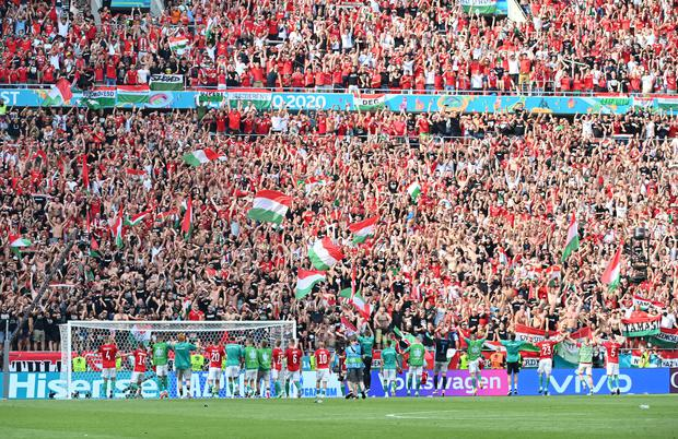 Hungary players and fans celebrate after the Euro 2020 Group F draw with France at the Puskas Arena, Budapest
