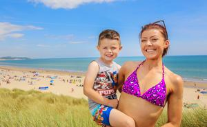 Curracloe beach feature. Nicola Chaplin and her son Luke 4) from Broadford Co. Clare on the beach. Picture; Gerry Mooney.