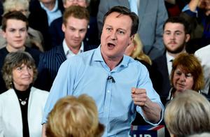Britain's Prime Minister David Cameron gestures as he speaks at an election rally in St Ives. Photo: Reuters